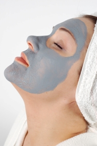 Woman Getting 4 layer mask from Carolyn @ Legends Salon